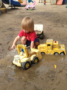 Playing in the wet sand puddles after the storm.